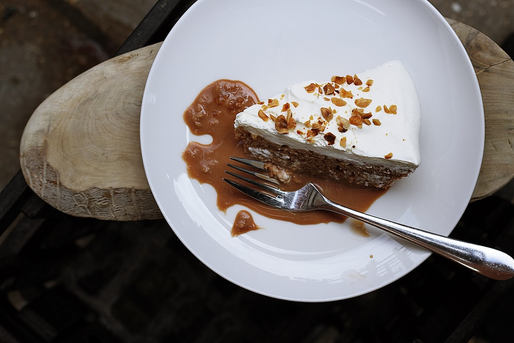 Slice of gooey, caramel cake with nuts