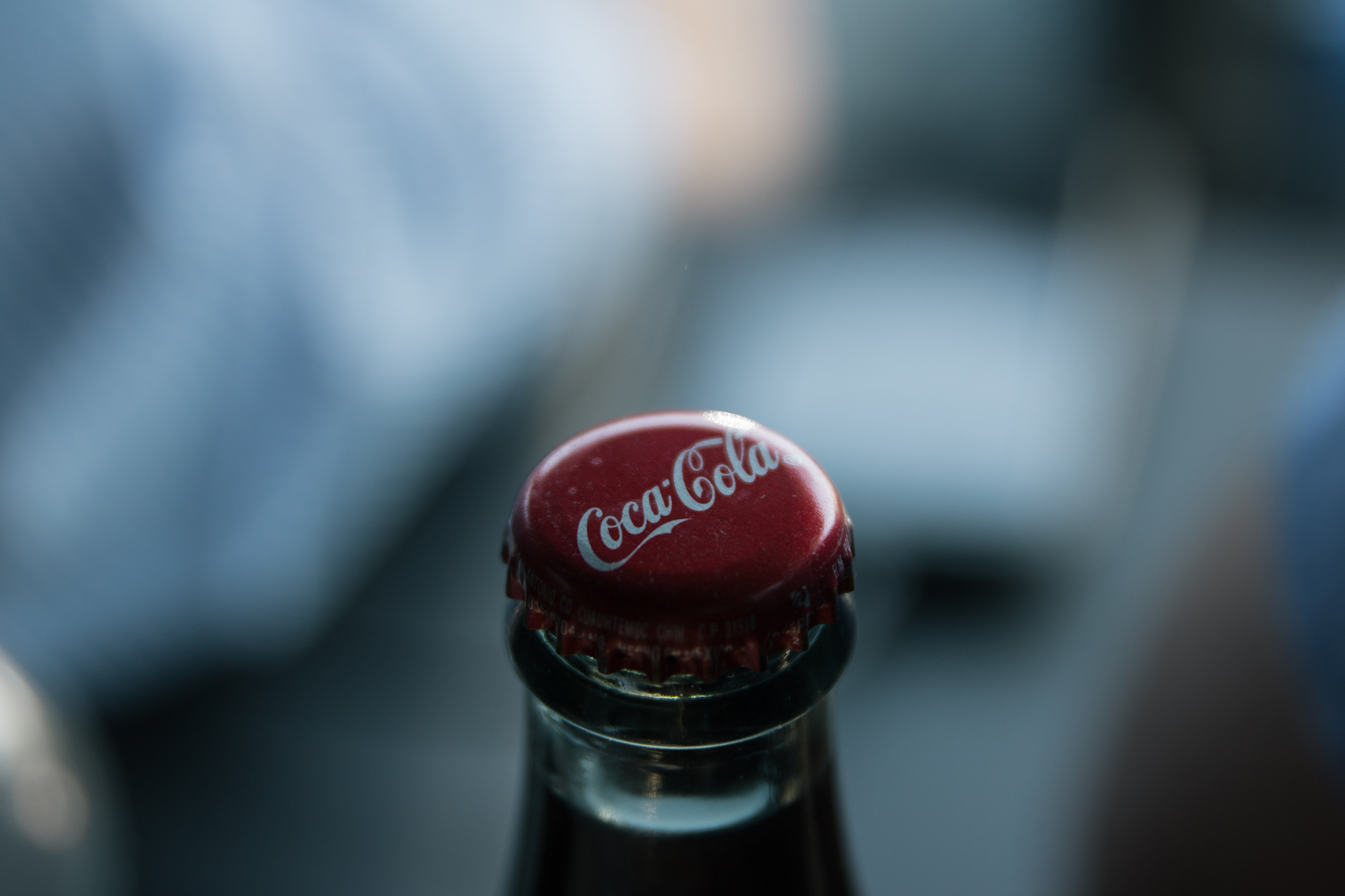 The bottle cap of a bottle of Coca-Cola in Raleigh