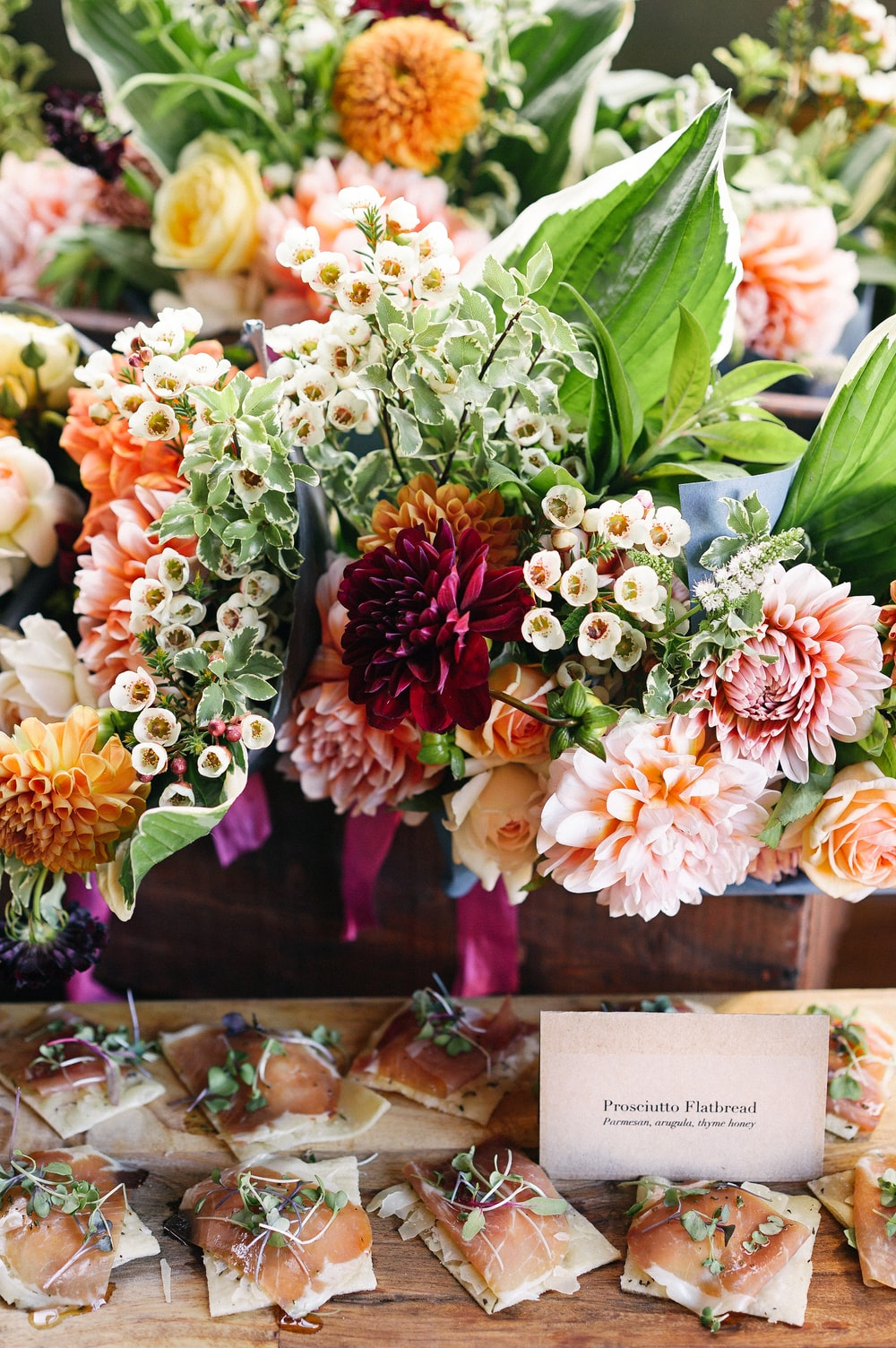 Dessert champagne and flowers photo by sasha stories bouquet of flowers with salami prosciutto flatbread snacks on table in spring izmirmasajfo Gallery