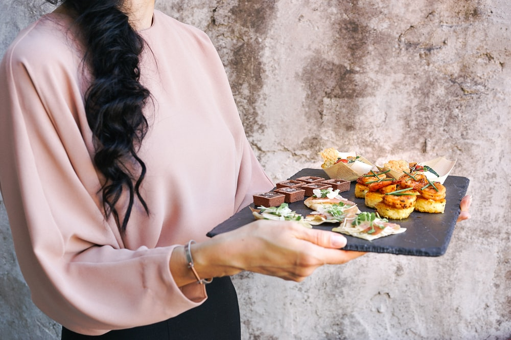 person holding tray with foods
