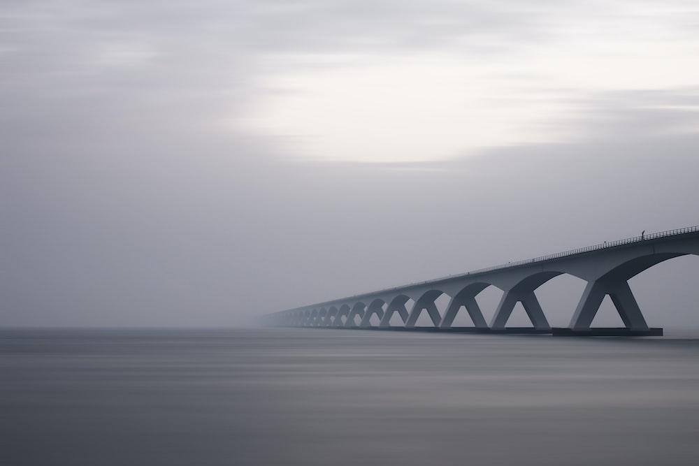 conjunction bridge under white sky