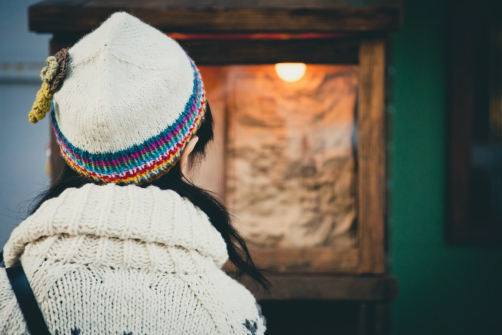 selective focus photo of person wearing beanie and sweater