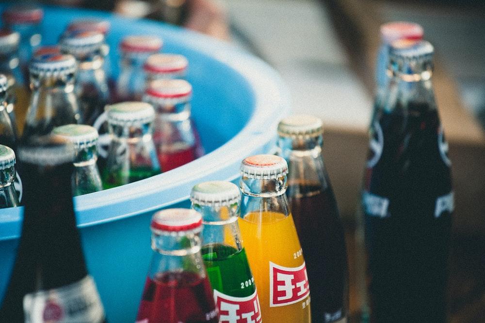 closeup of soda bottles beside basin