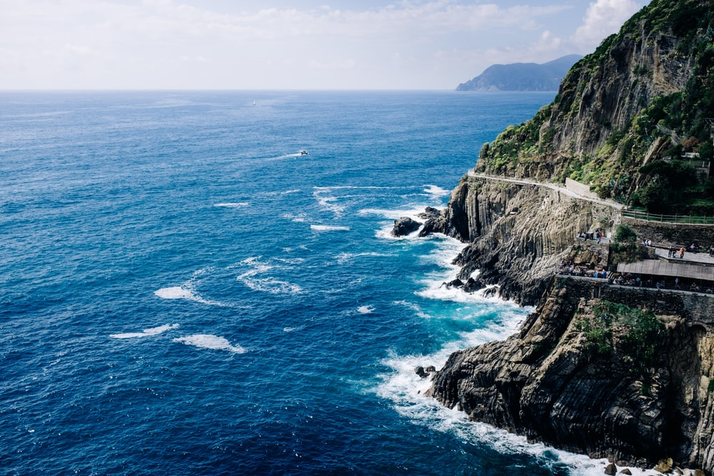 rocky mountain surrounded by ocean nature photography