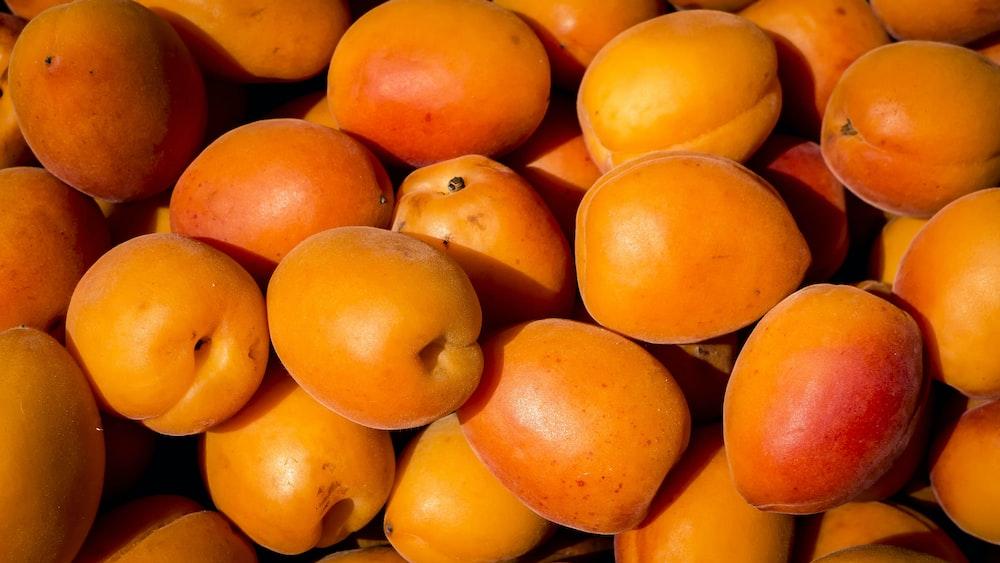 shallow focus photography of orange fruit lot