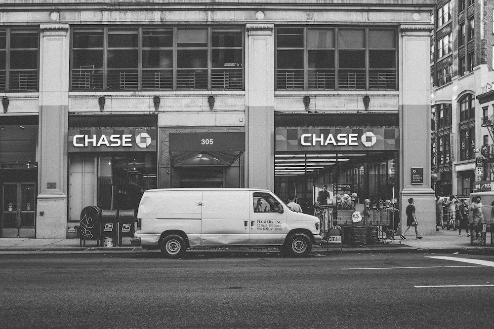 white van parked beside building
