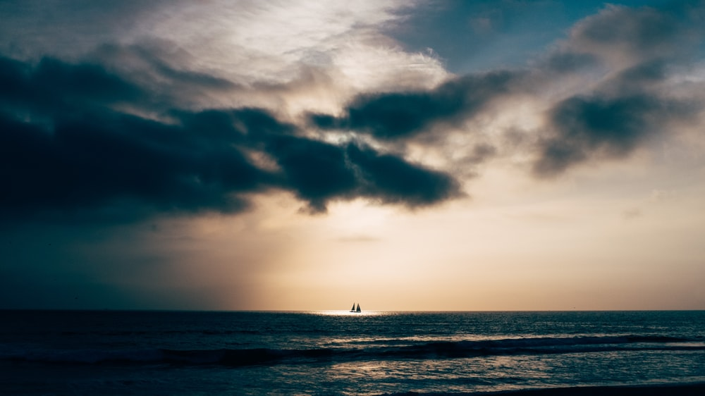 calm sea under blue sky