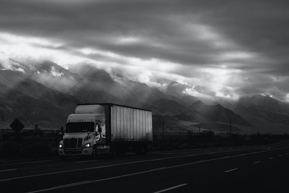 white trailer truck on road