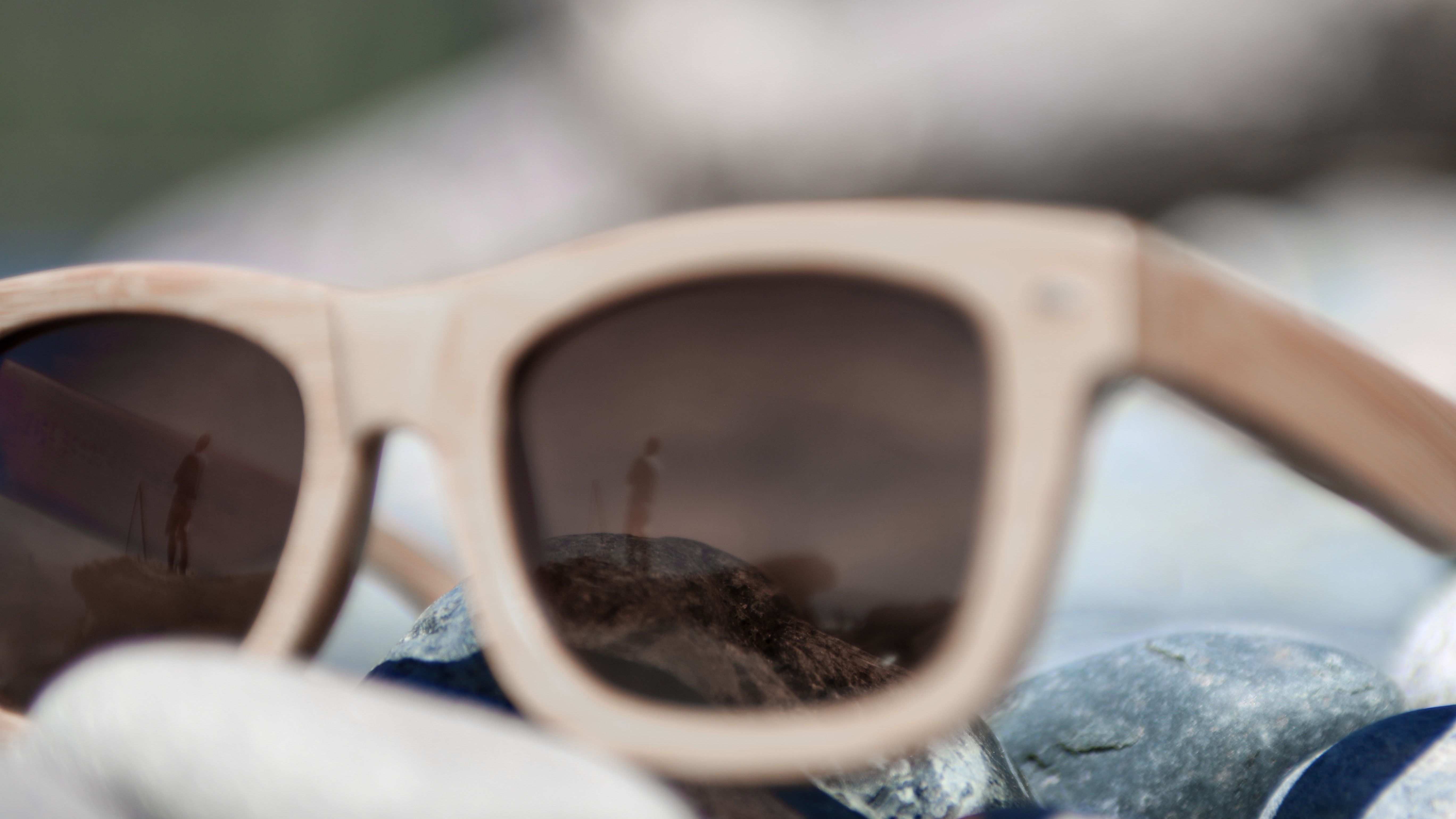 Man reflected in the wooden frame sunglasses on the rock at French Beach