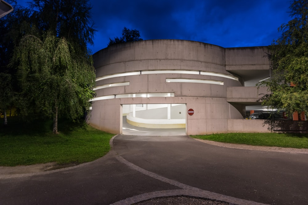 photography of gray concrete building at night time