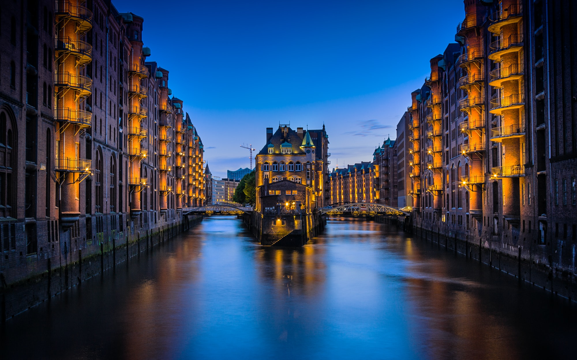 """This photo was taken in the """"Speicherstadt"""" District in Hamburg (Germany). On midday this place looks kind of boring but in the late evening, the lights go on and the place turns into a great photo spot."""