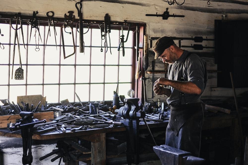 man inside tool shed