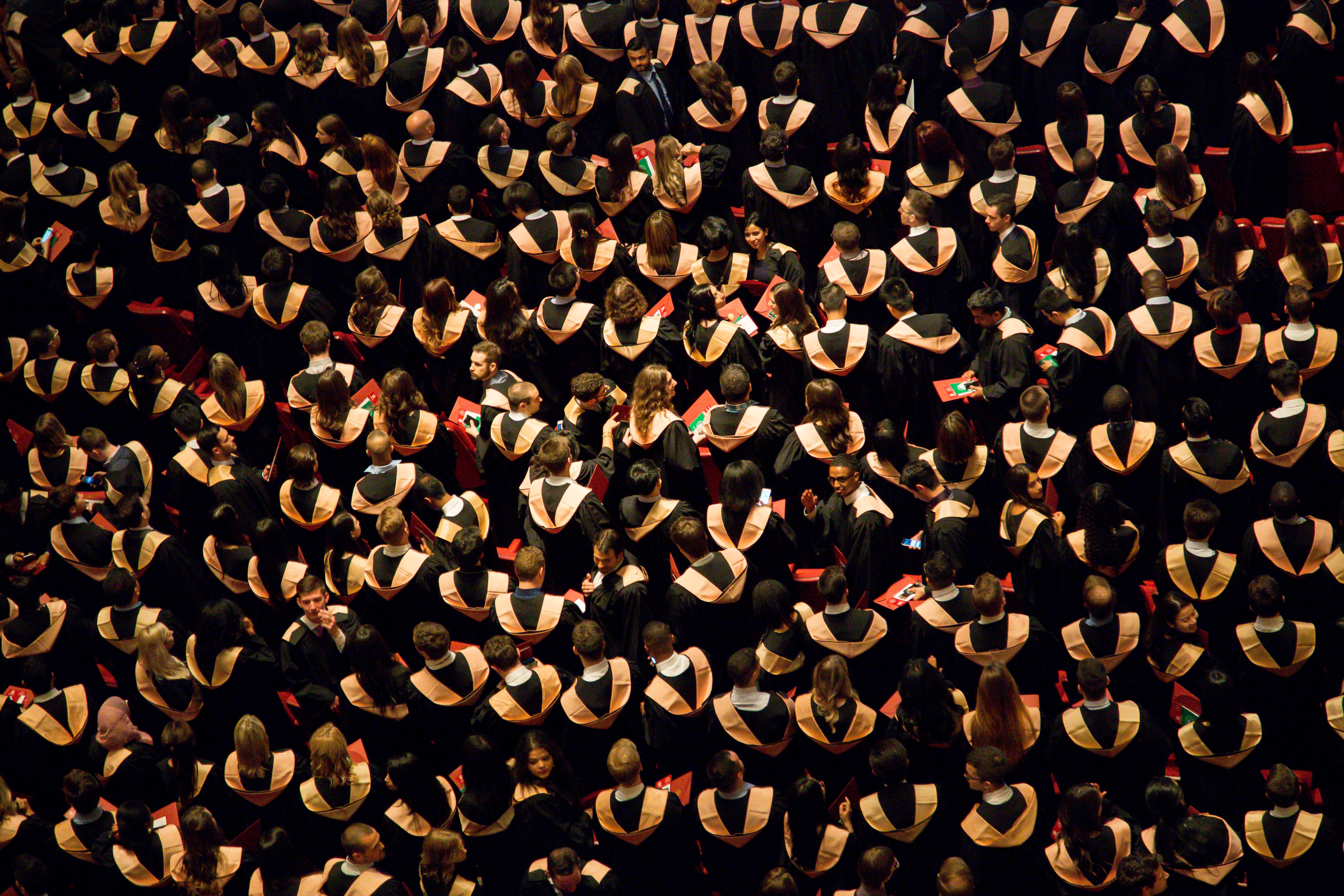A large crowd of students at a university graduation ceremony