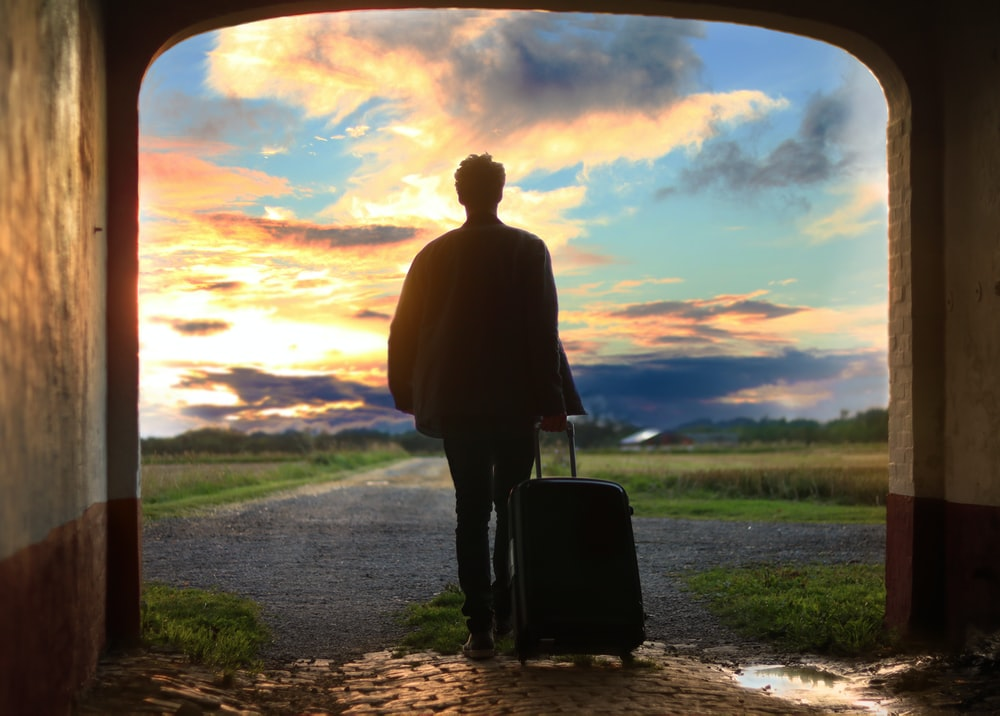 man holding luggage photo