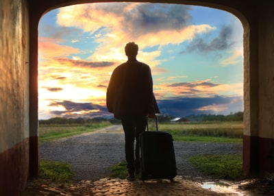 man holding luggage photo