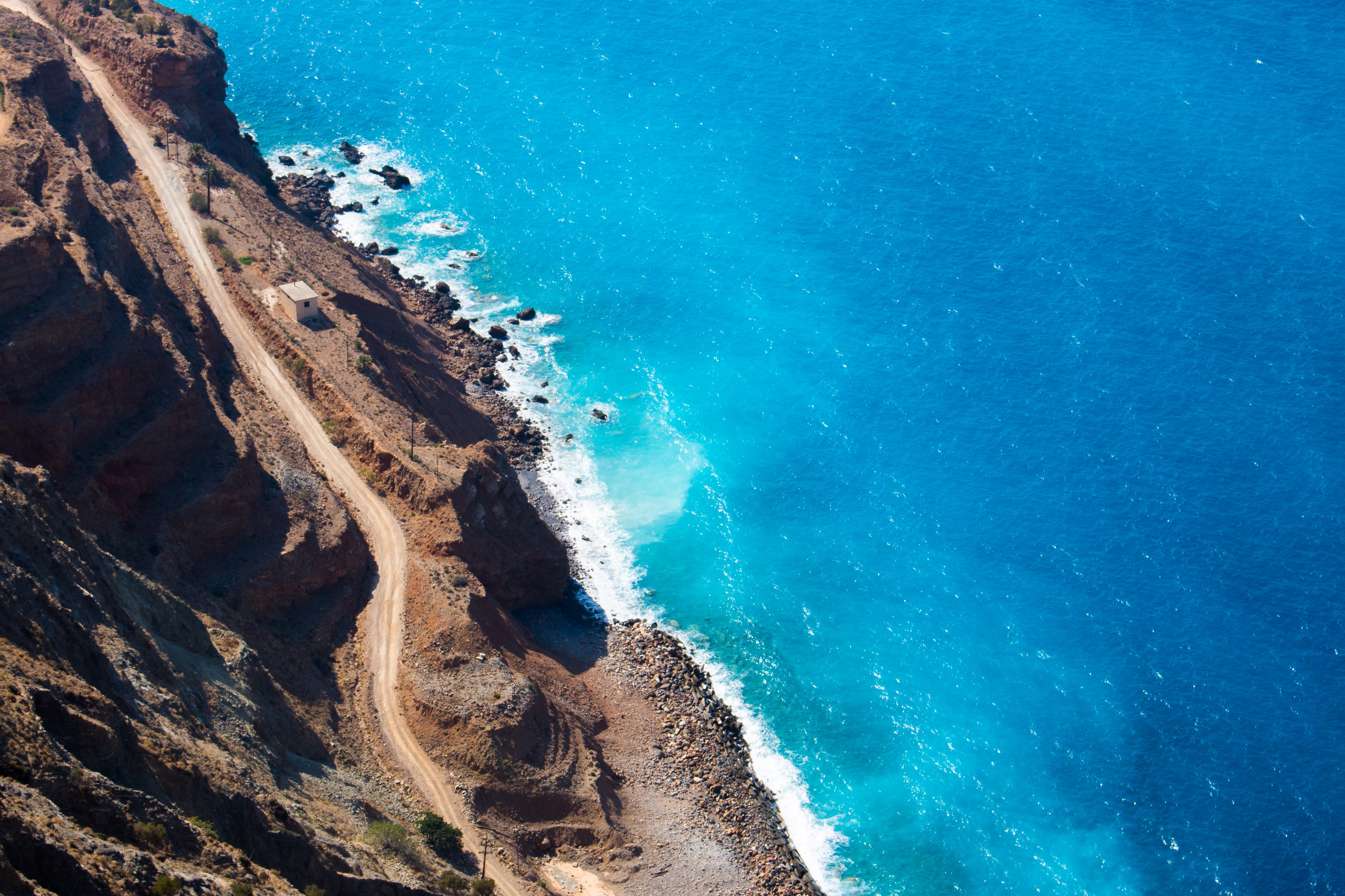 aerial photography of cliff near sea