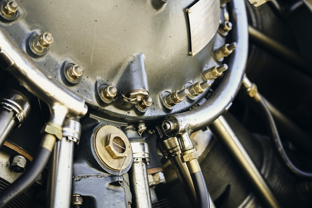 close up photography of gray engine part