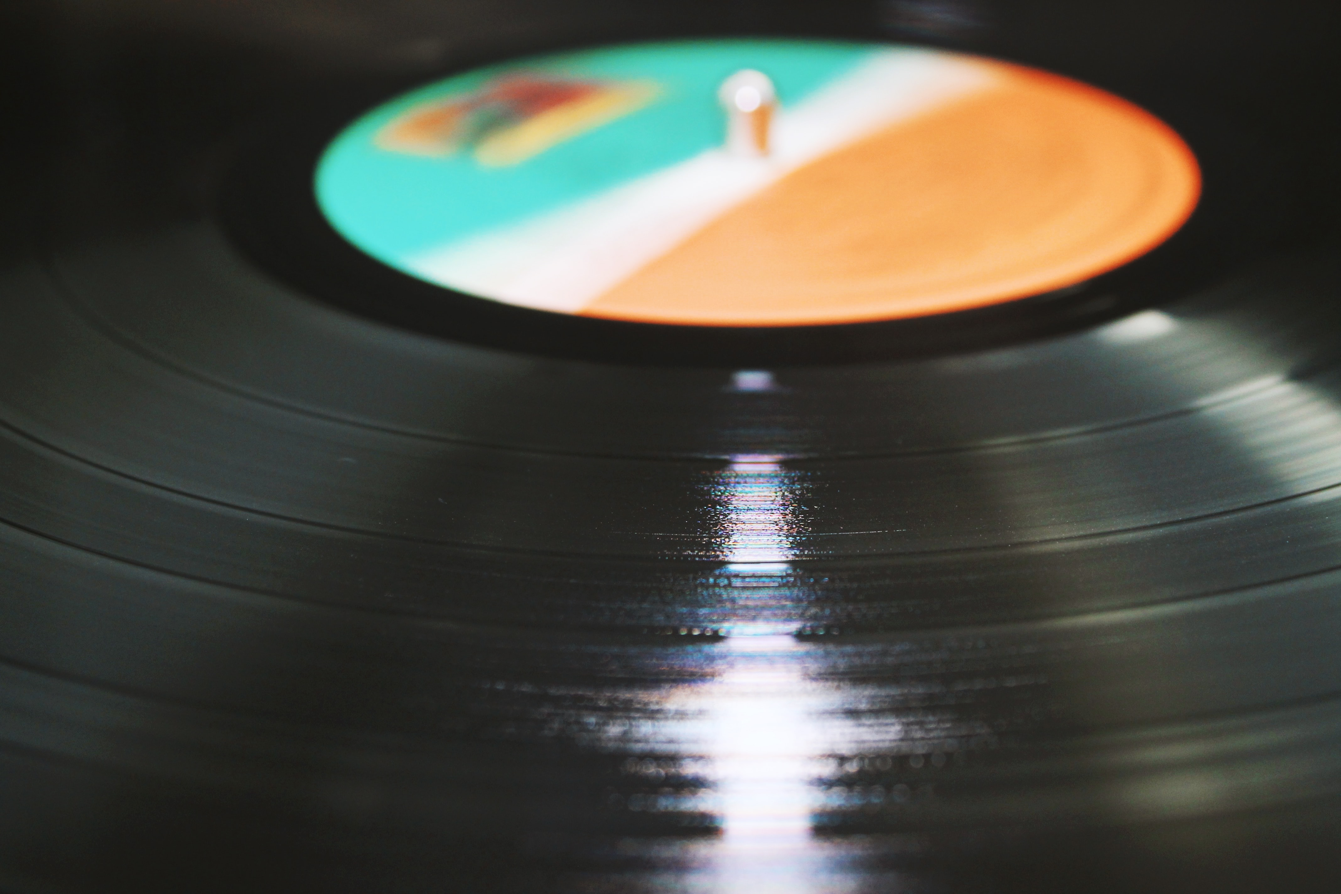 A close-up of the spinning surface of a vinyl record