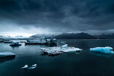 glacier near body of water