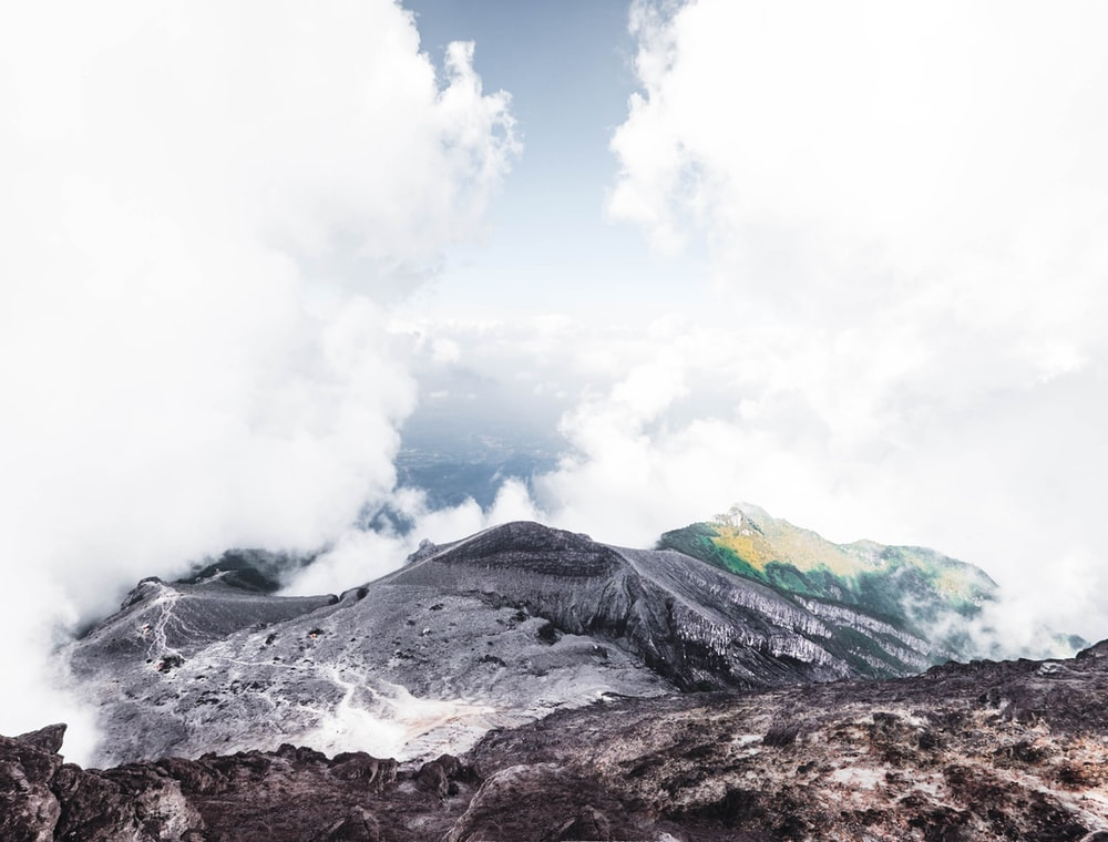 landscape photography of mountain surrounded by clouds