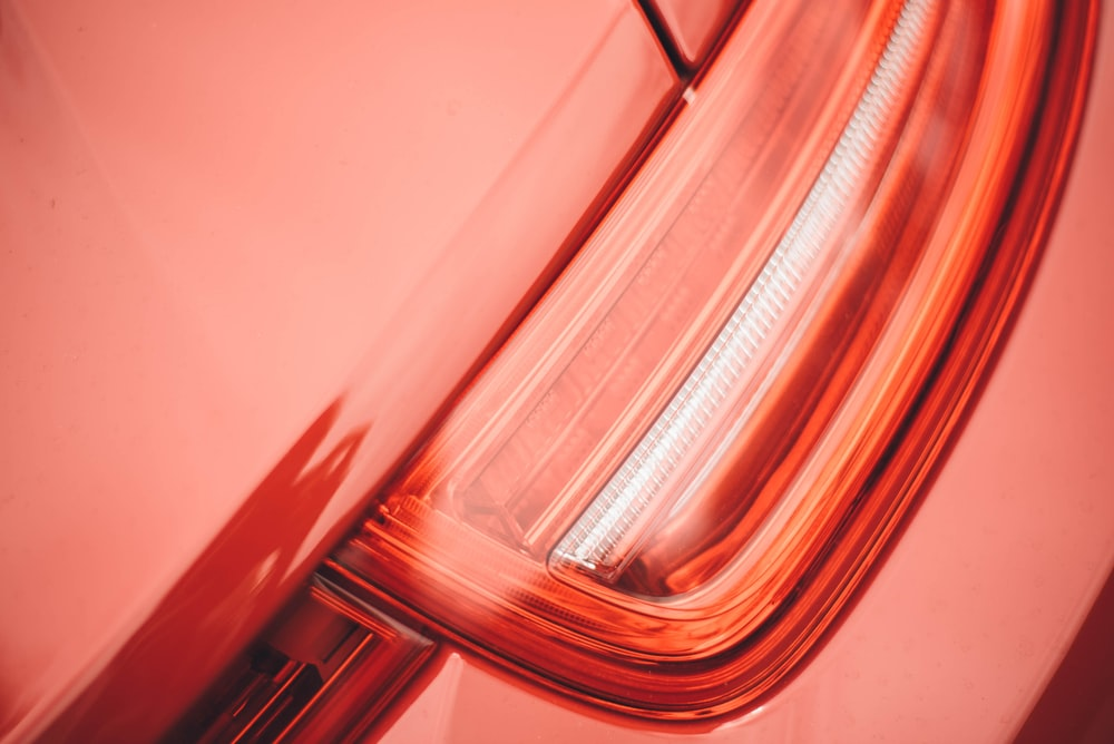 Macro shot of a red car's tail light.