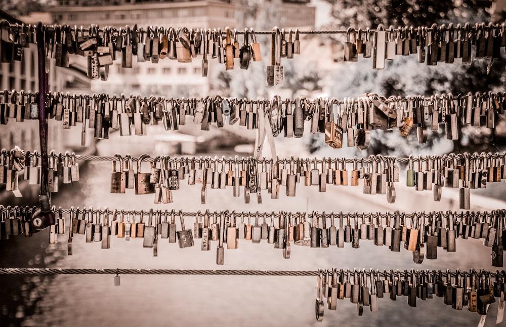assorted padlocks hanged on wire
