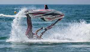 Jetski and stunt rider upside down. Get an Insurance Quote for your boat or jetski. - www.The-MillerInsuranceAgency.com.