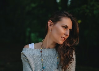 shallow focus photography of woman in gray sweater