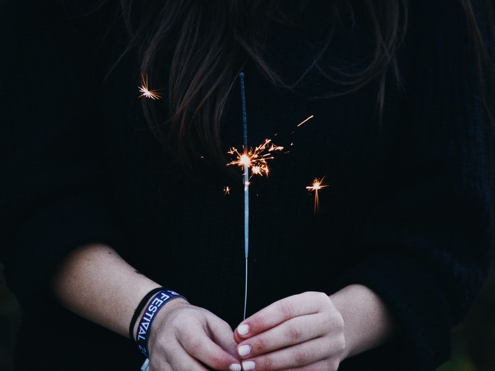 person holding firecracker