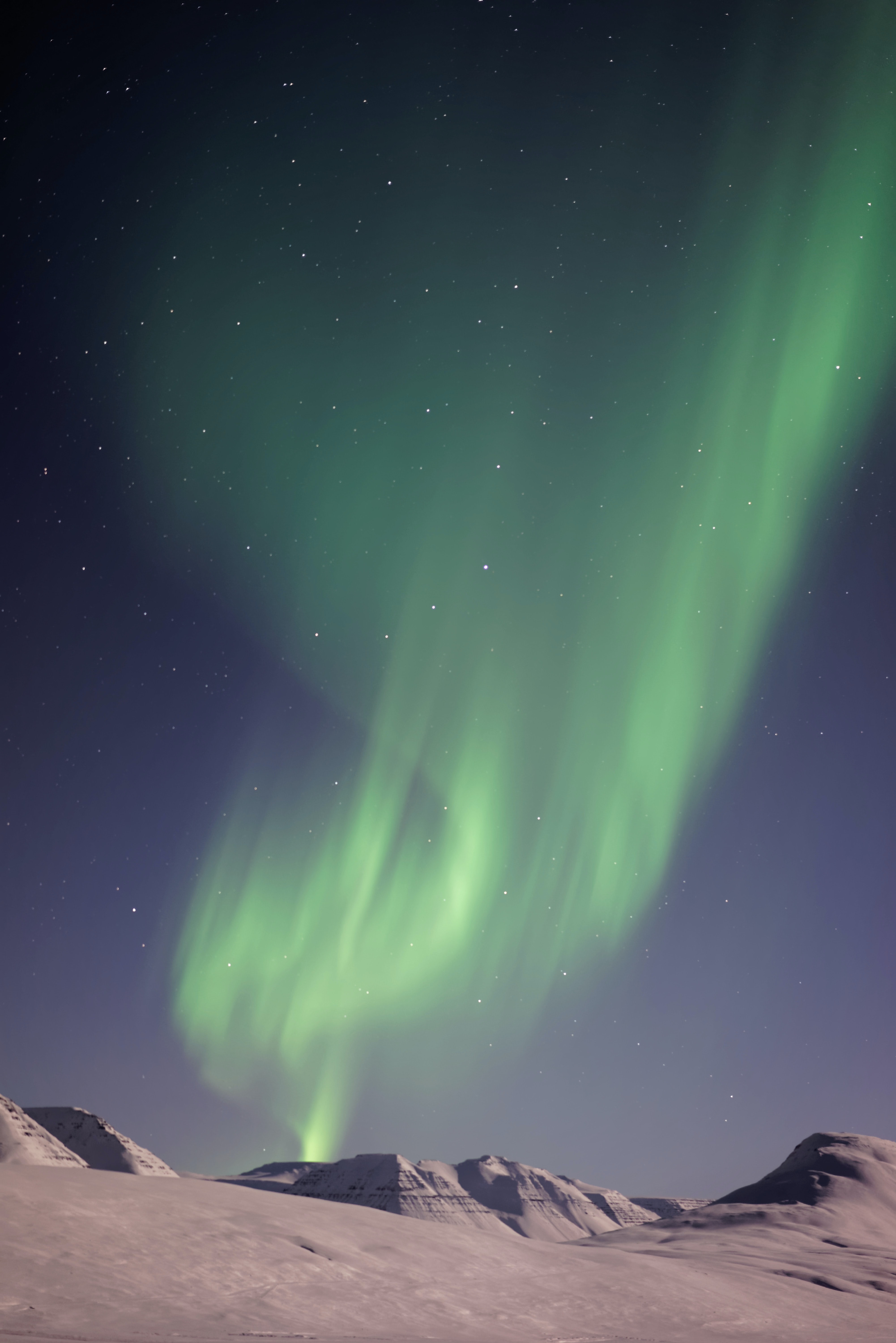 Green Northern Lights above the hills in Sauðárkrókur