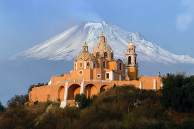 aerial photography of orange cathedral mexico zoom background