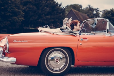 two person riding vintage coupe
