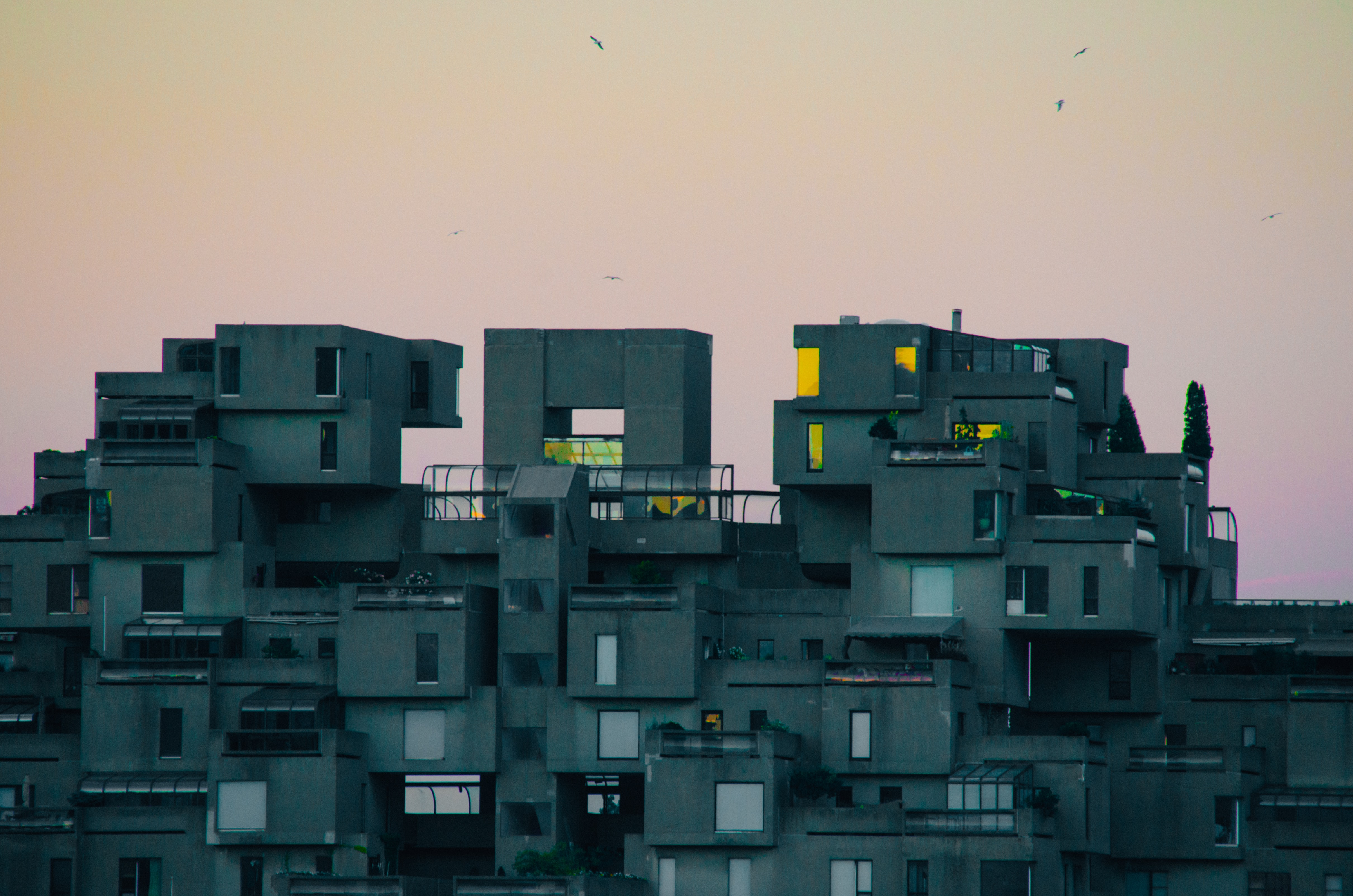 View of modern architecture building, Habitat 67, in Montreal with a pastel sunset in the background