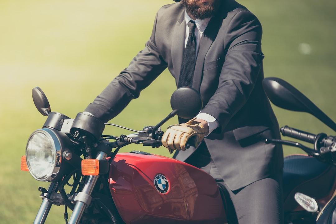 Elegant man on a motorbike