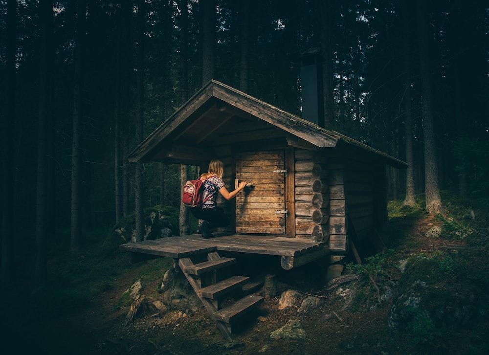 girl knocking on wooden door