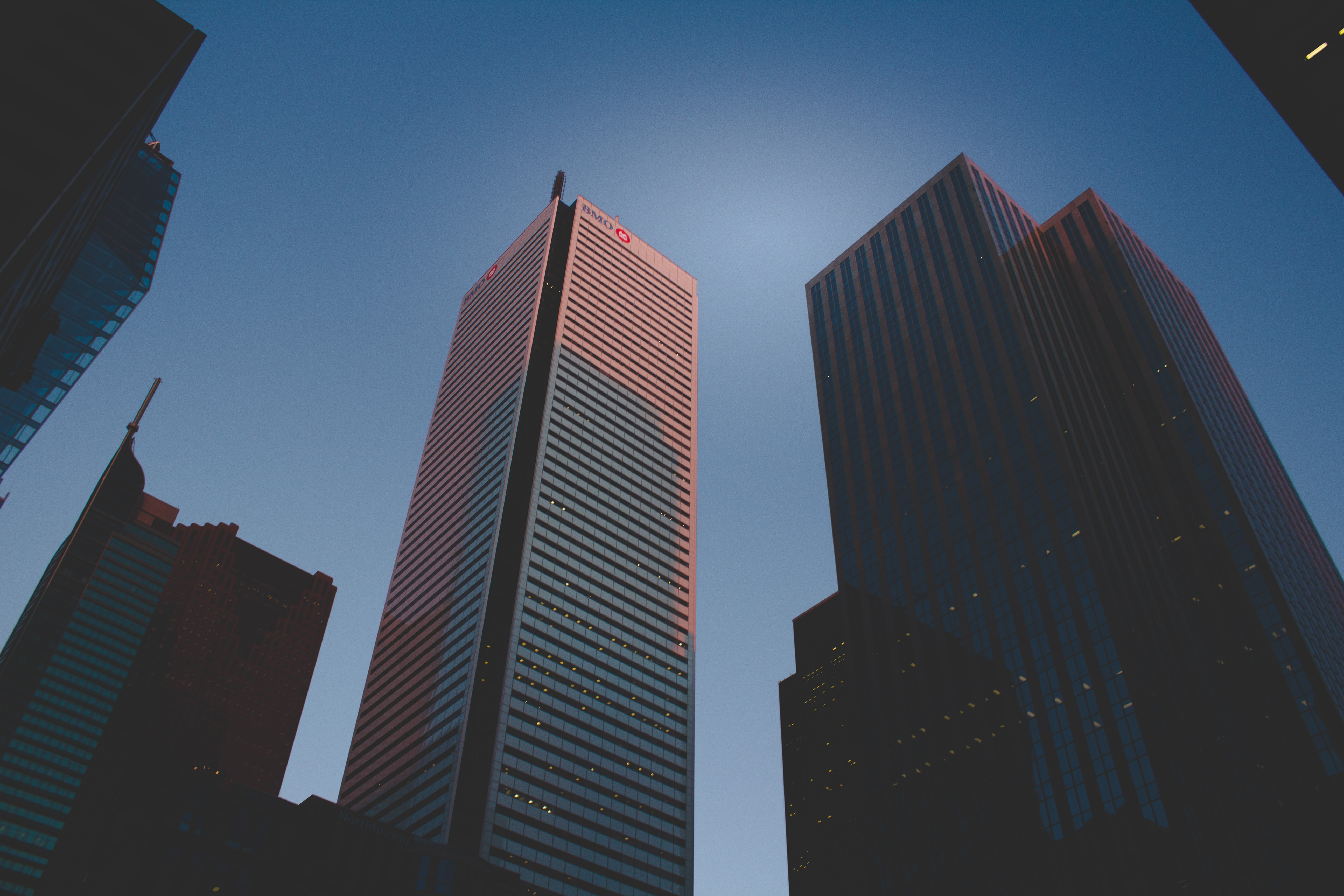 worm's eye view of high-rise city buildings during daytime