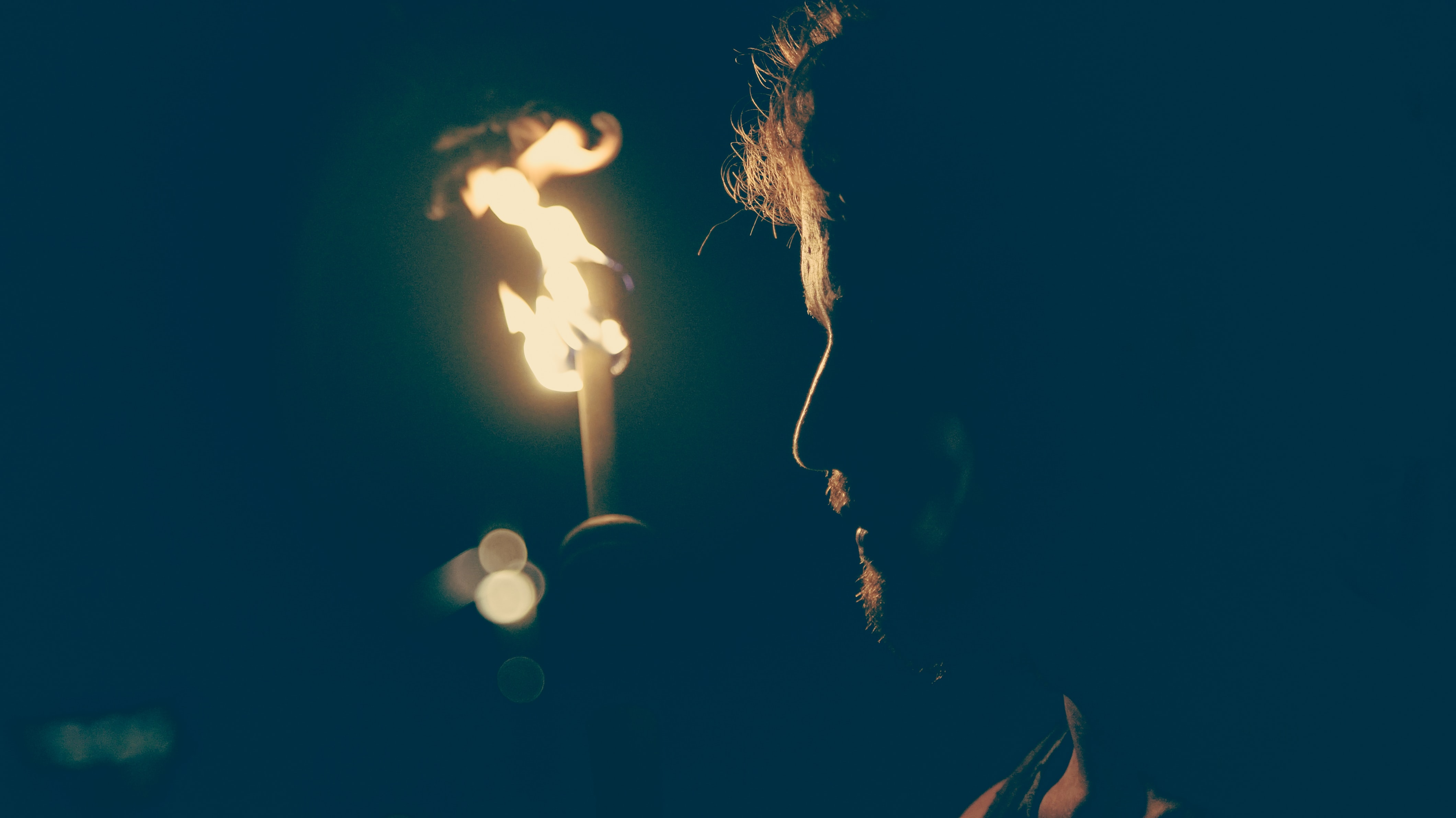 man standing in front of candle