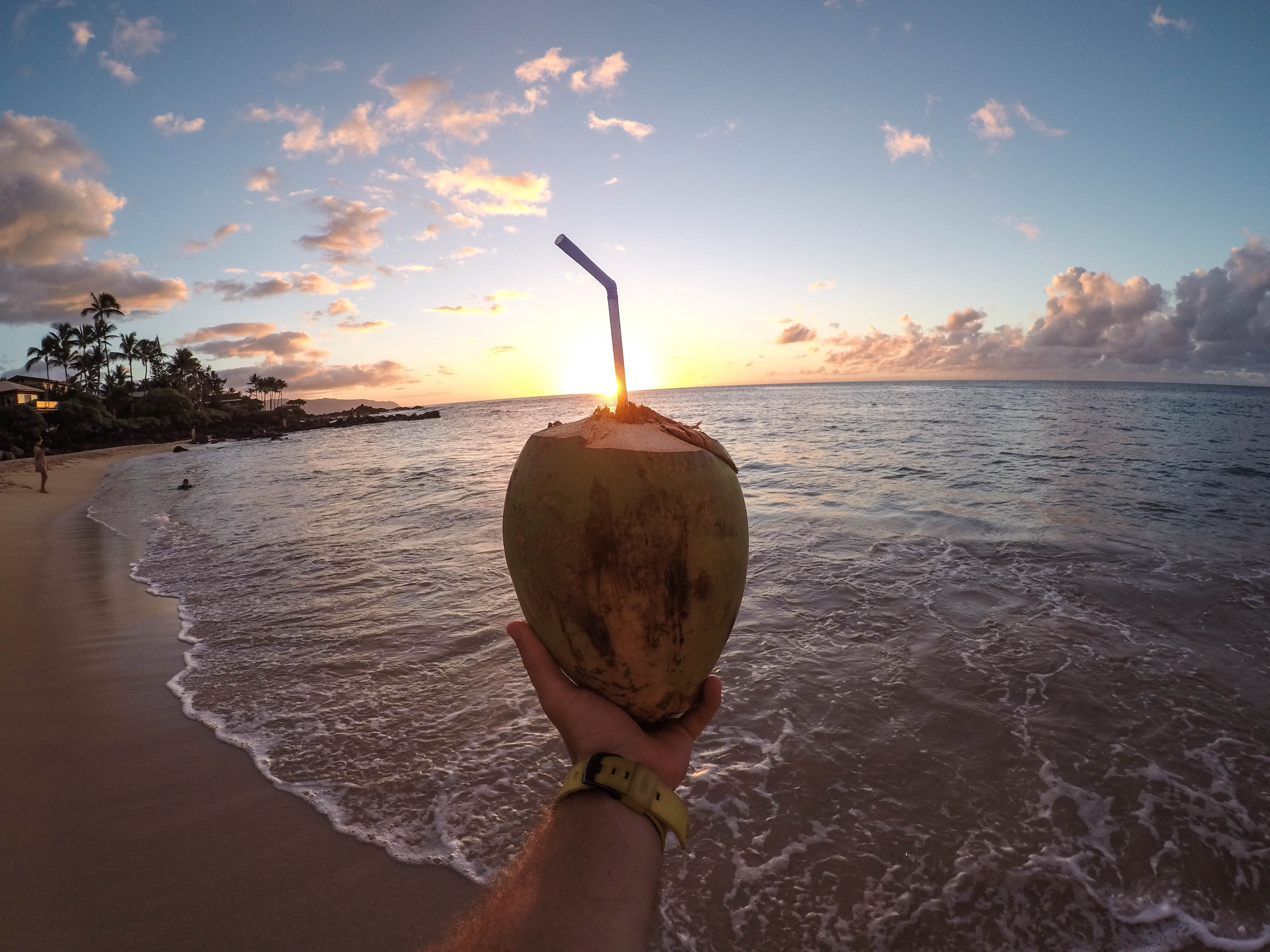Drinking with a straw out of a fruit in Hawaii.