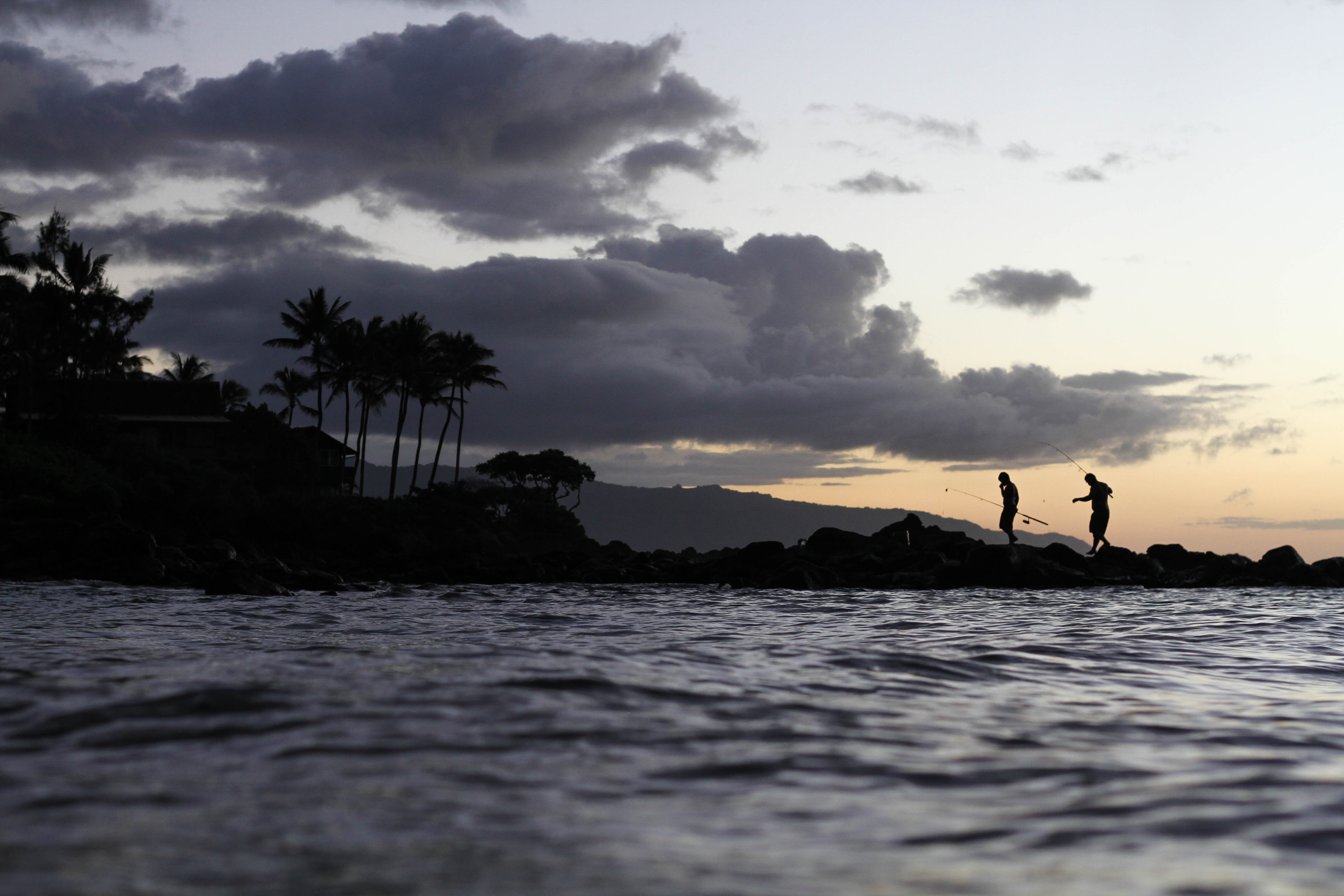People out in the ocean in Hawaii.