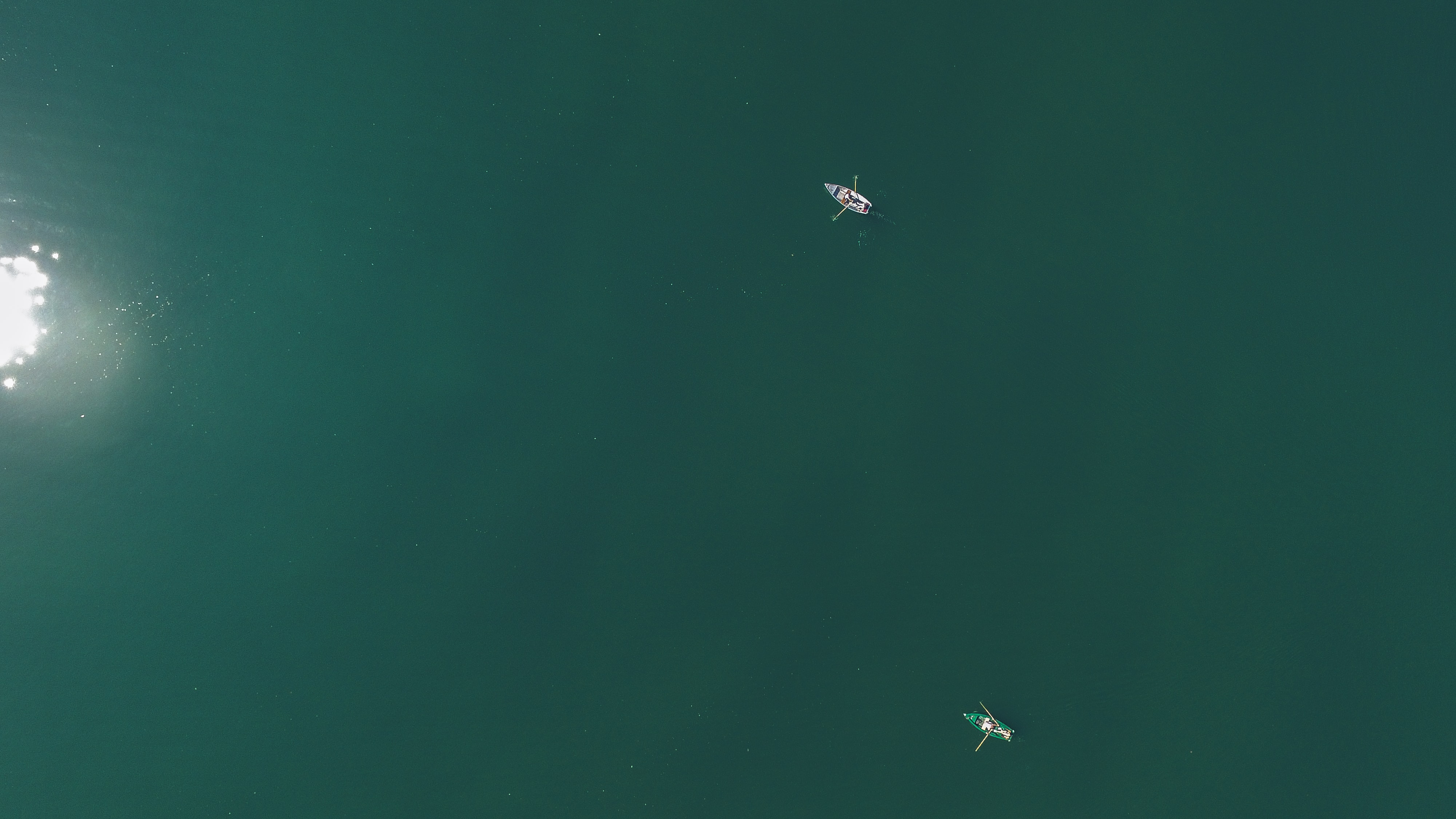 aerial photography of two boats on body of water