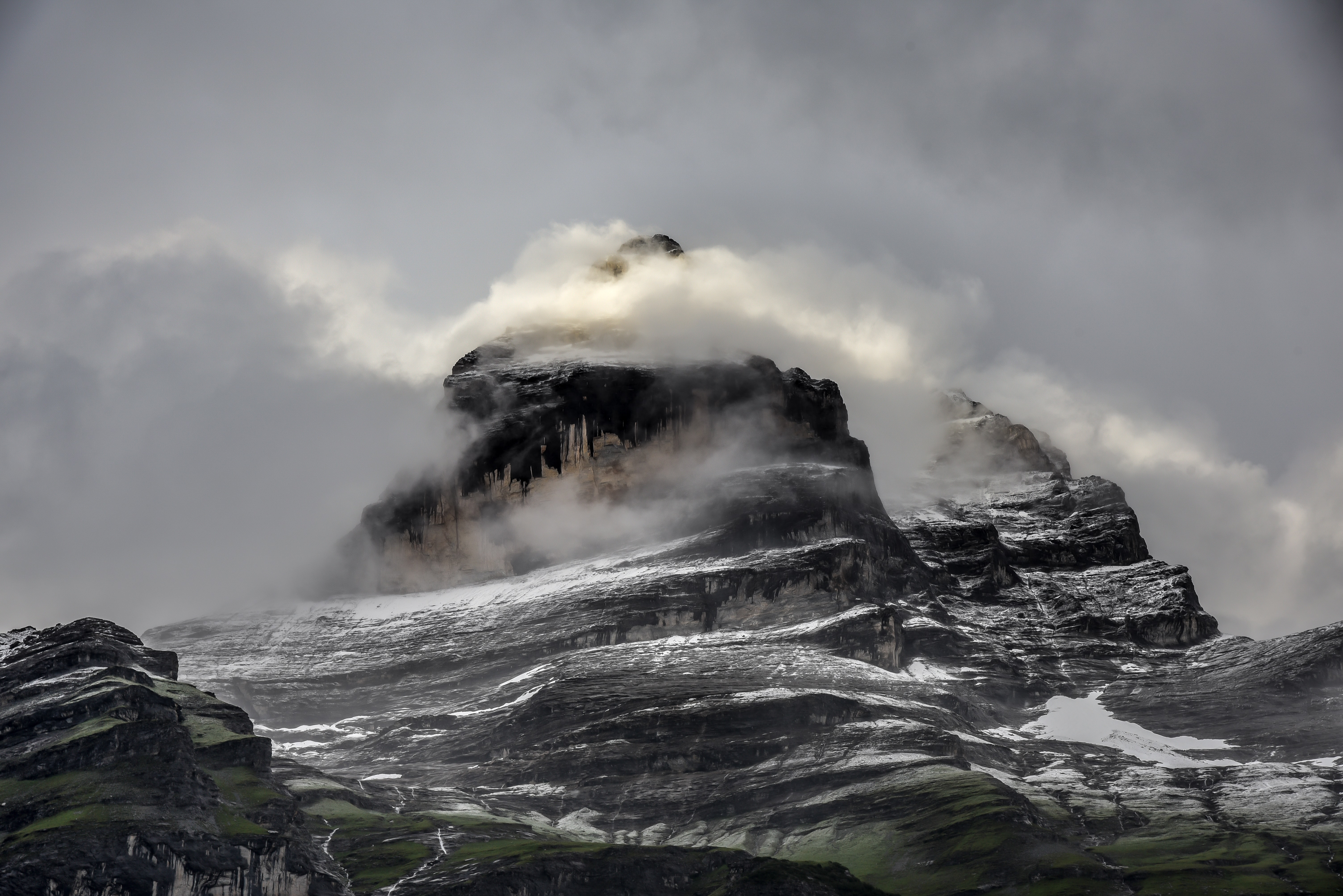 Mist covers a rocky mountain crag in Mürren