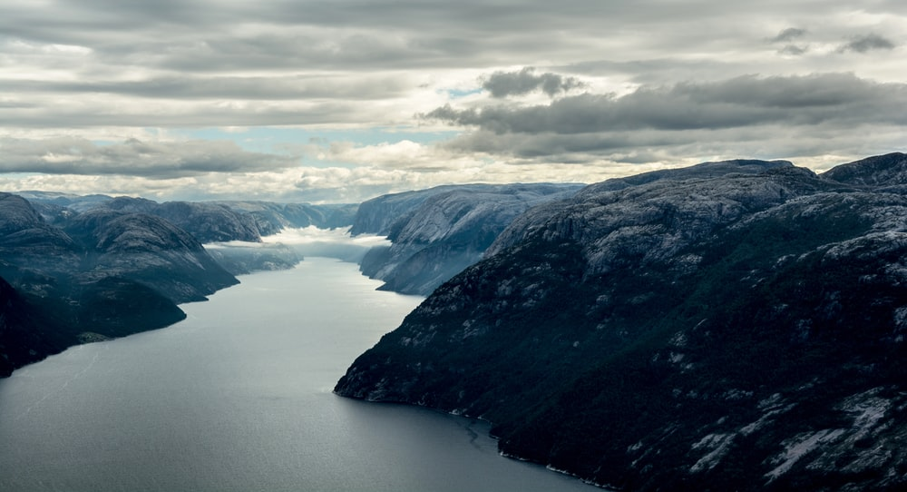 aerial view of mountains and body of water