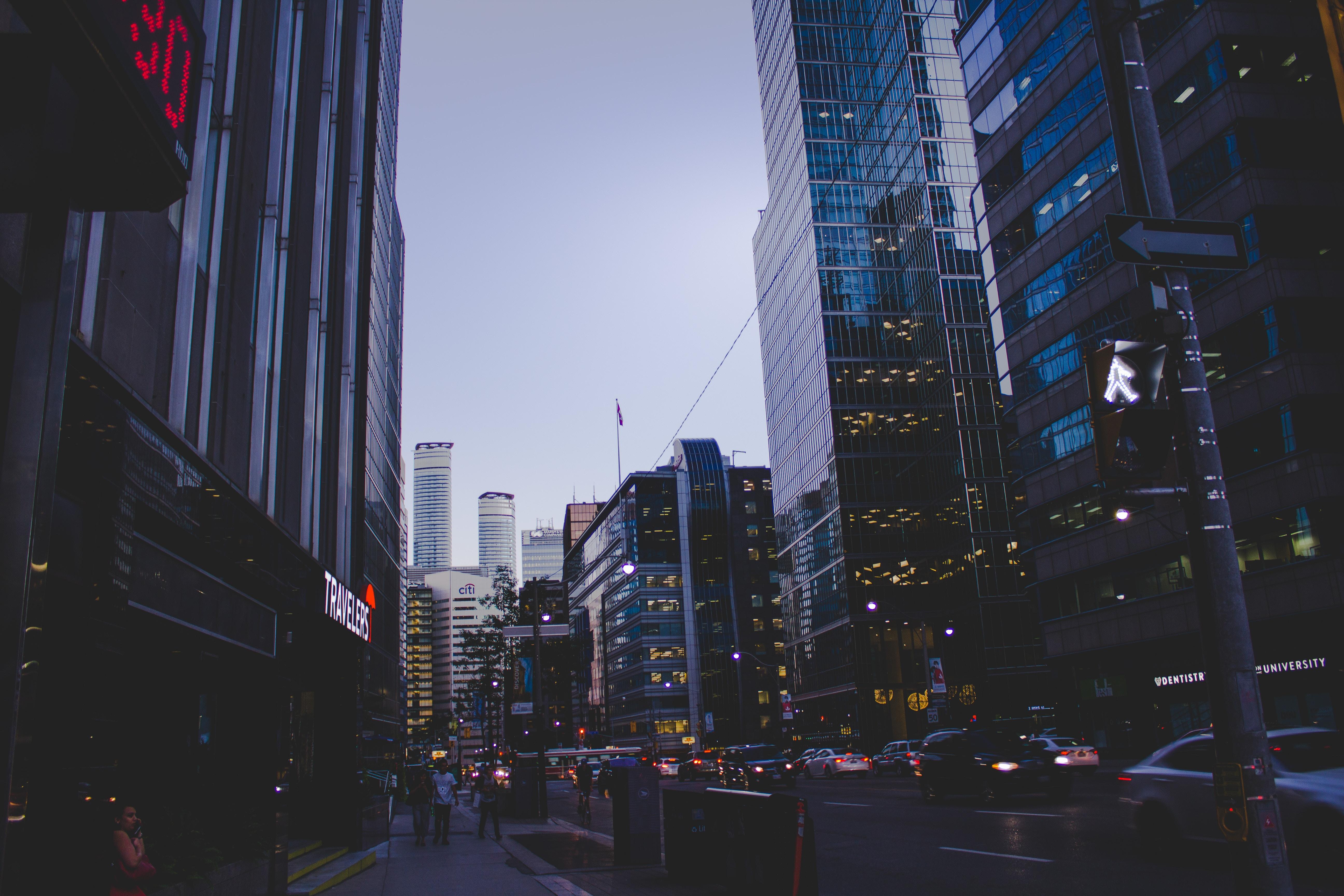 people walking around buildings