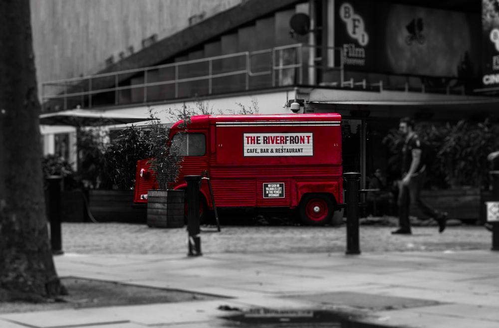 selective color photo of red van
