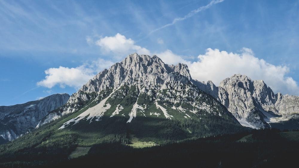 photo of grey mountain under blue sky