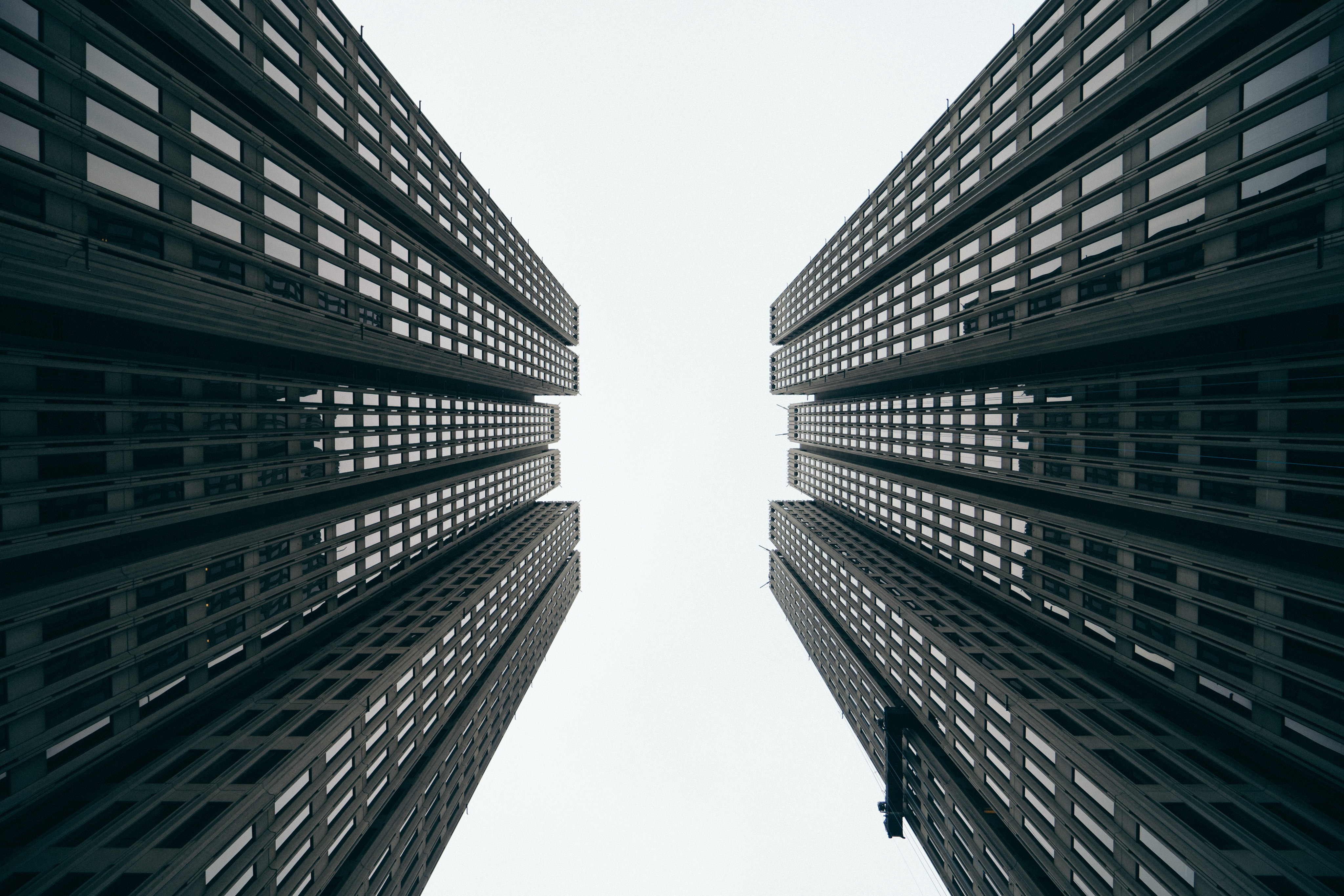 A low-angle shot of two twin skyscrapers in San Francisco