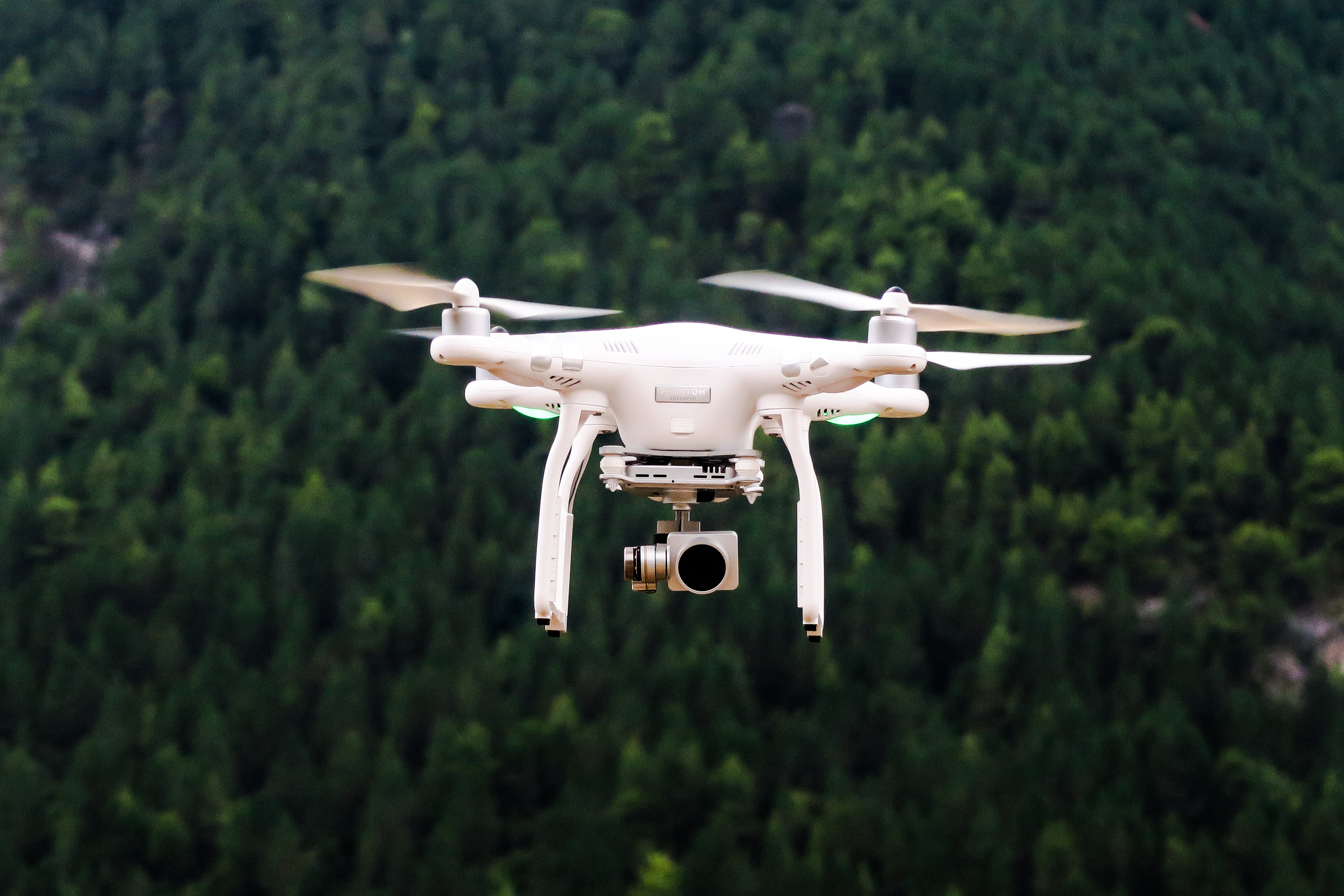 A drone being flown in the forest in Agridi