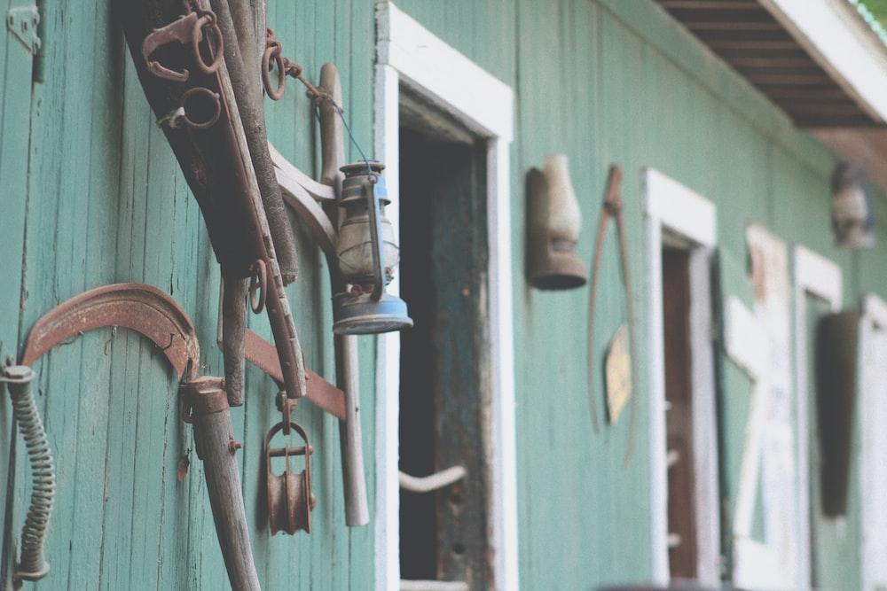 blue kerosene lamp hanged on wall rack