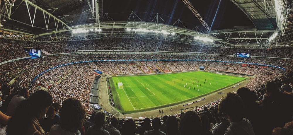 crowd watching football game inside stadium