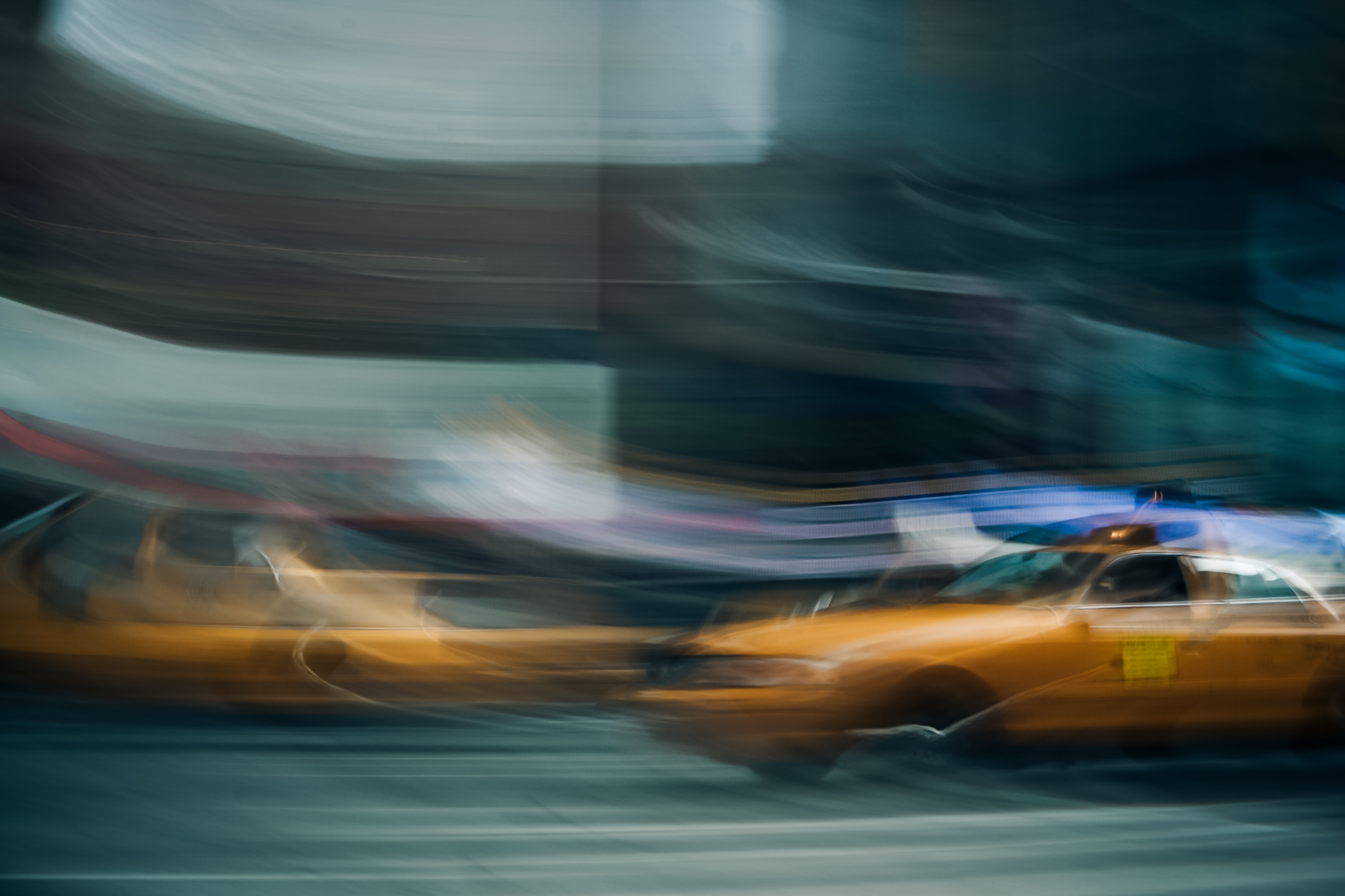 A blurry shot of a yellow taxi cab in New York City